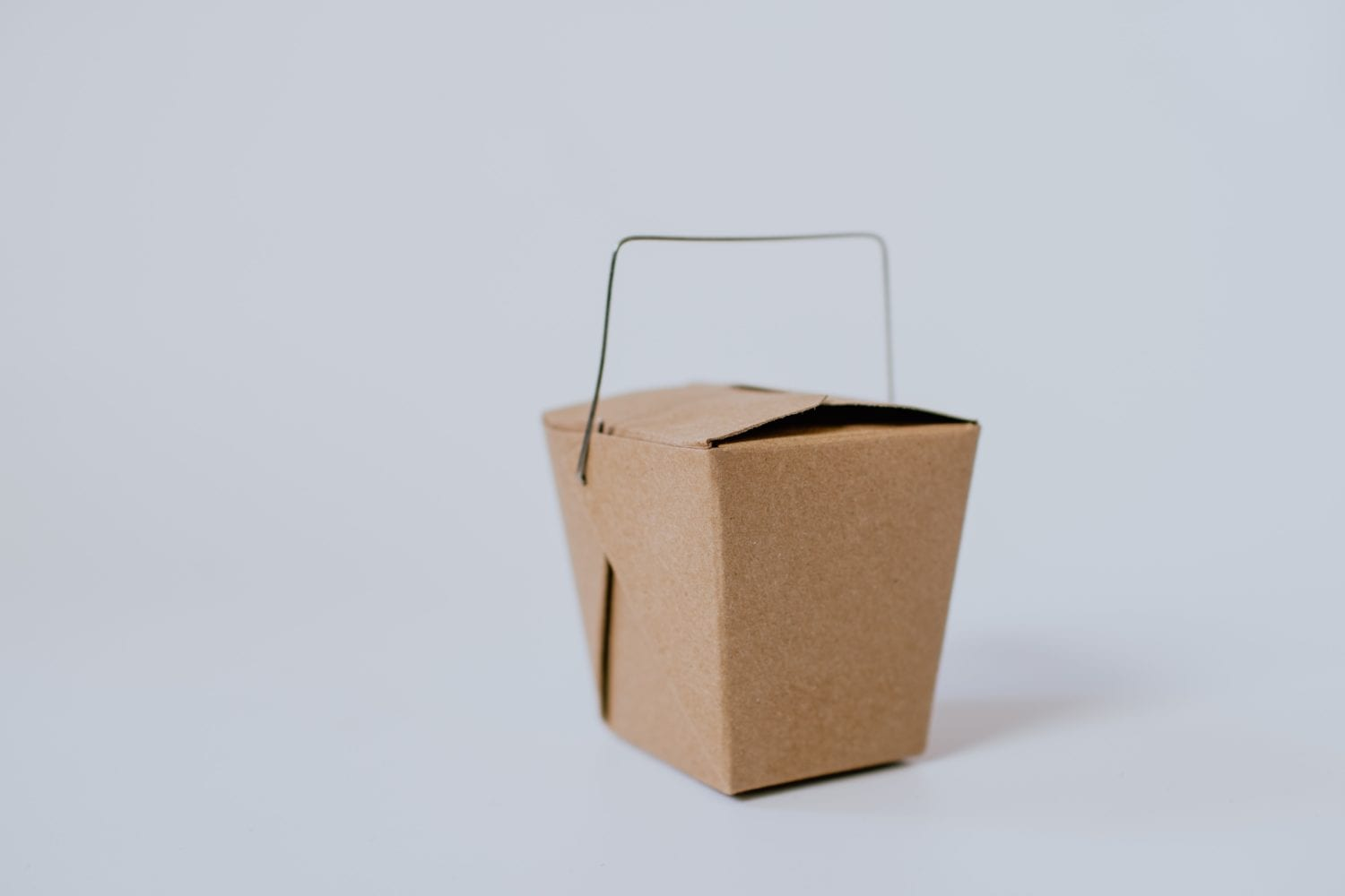 small brown cardboard box with handle